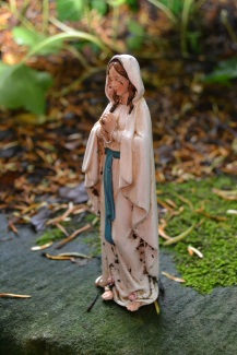 Our Lady looks over pilgrims to the well copyright PIxyledpublications