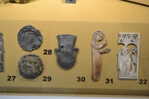 Typical ampulla among Pilgrim badges in Lynn Museum
